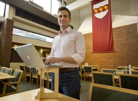 Luke Leafgren and his portable computer stand invention at Harvard.